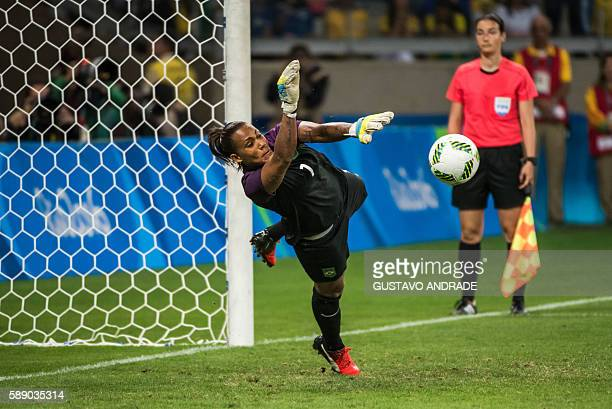 Brazil's goalkeeper Barbara stops a penalty during the penalty shootout of the Rio 2016 Olympic Games women's quarterfinal football match against...