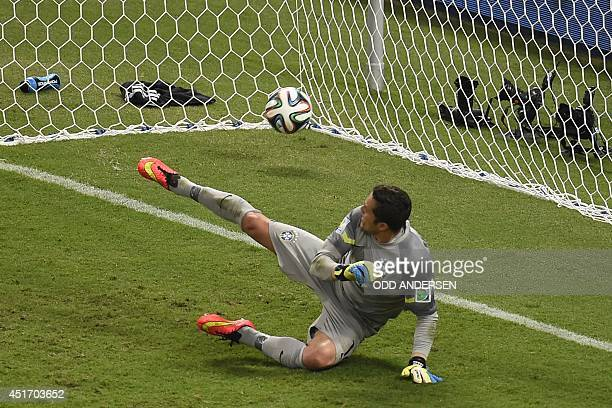 Brazil's goalkeeper Julio Cesar concedes a penalty during the quarterfinal football match between Brazil and Colombia at the Castelao Stadium in...
