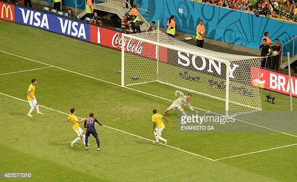 Brazil's goalkeeper Julio Cesar fails to save a goal by Netherlands' midfielder Georginio Wijnaldum during the third place playoff football match...