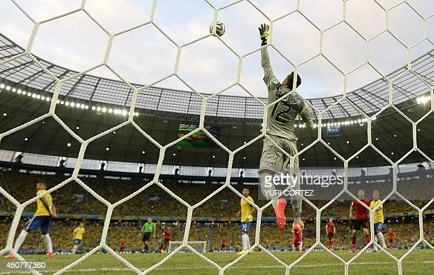 Brazil's goalkeeper Julio Cesar jumps for the ball during a Group A football match between Brazil and Mexico in the Castelao Stadium in Fortaleza...