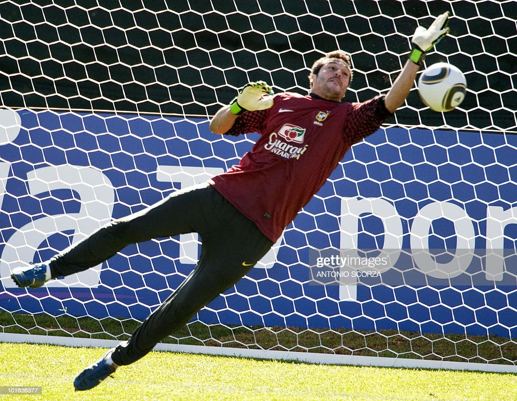 Brazil's goalkeeper Julio Cesar tries to catch the ball during a training session at Randburg High School in Johannesburg, on May 29, 2010 ahead of the 2010 FIFA football World Cup held in South Africa. AFP PHOTO/ ANTONIO