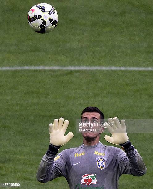 Brazil's goalkeeper Marcelo Grohe eyes the ball on March 25 2015 during a training session on the eve of the team's friendly football match against...