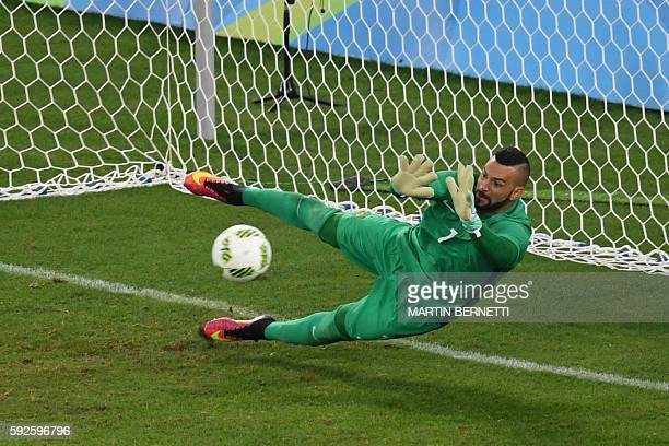 Brazil's goalkeeper Weverton Pereira da Silva makes a save during the penalty shootout of the Rio 2016 Olympic Games men's football gold medal match...