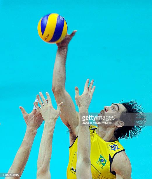 Brazil's Godoy Filho Gilberto spikes the ball against Russia during their Volleyball World League gold medal game in Gdansk on July 10 2011 AFP PHOTO...