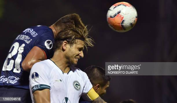 Brazil's Goias player Rafael Moura vies for the ball with Paraguay's Sol de America player Milciades Portillo during their Copa Sudamericana football...