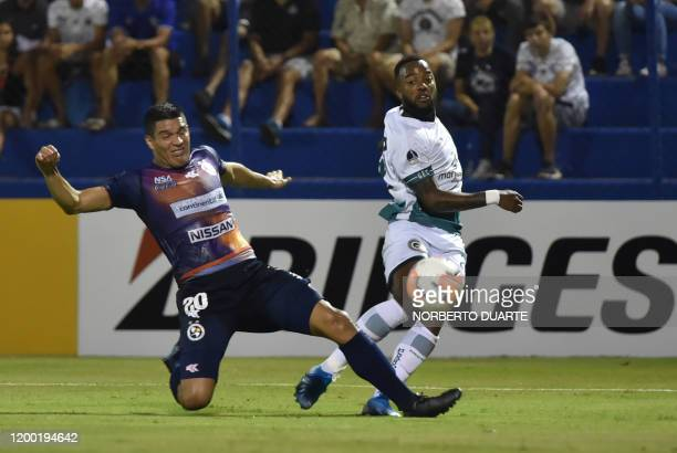 Brazil's Goias player Victor Andrade vies for the ball with Paraguay's Sol de America player Ivan Villalba during their Copa Sudamericana football...