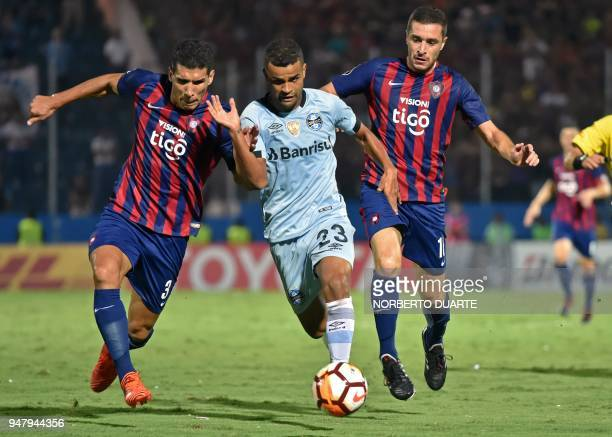 Brazil's Gremio Alisson vies for the ball with Paraguay's Cerro Porteno Marcos Caceres and Marcelo Palau during their 2018 Copa Libertadores football...