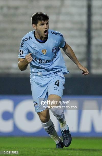 Brazil's Gremio Argentine defender Kannemann celebrates after scoring against Argentina's Estudiantes de La Plata during their Copa Libertadores...