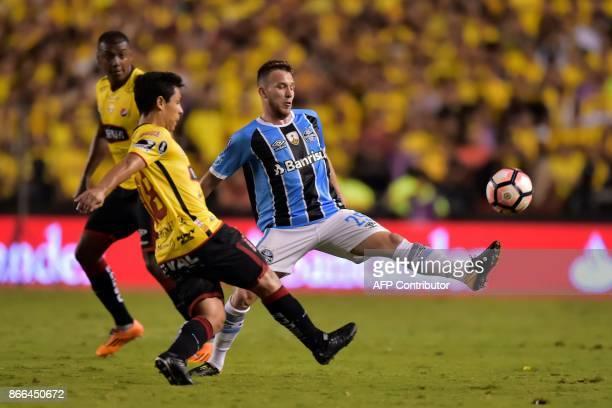 Brazil's Gremio Arthur vies for the ball with Ecuador's Barcelona Matias Oyola during their 2017 Libertadores Cup football match held al Monumental...