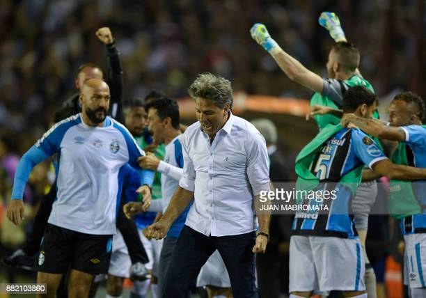 Brazil's Gremio coach Renato Gaucho celebrates after forward Fernandinho scored against Argentina's Lanus during the Copa Libertadores 2017 final...