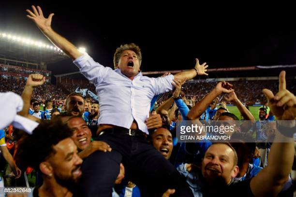 TOPSHOT Brazil's Gremio coach Renato Gaucho celebrates after his team defeats Argentina's Lanus during the Copa Libertadores 2017 final football...