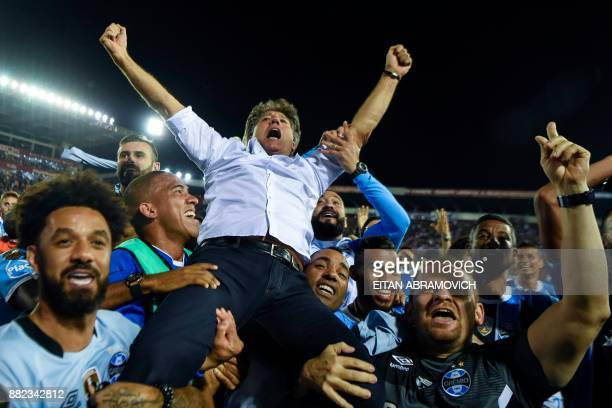 Brazil's Gremio coach Renato Gaucho celebrates after his team defeats Argentina's Lanus during the Copa Libertadores 2017 final football match at...