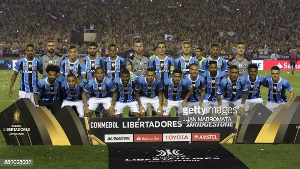 Brazil's Gremio football team pose during the Copa Libertadores 2017 final football match against Argentina's Lanus at Lanus stadium in Lanus Buenos...