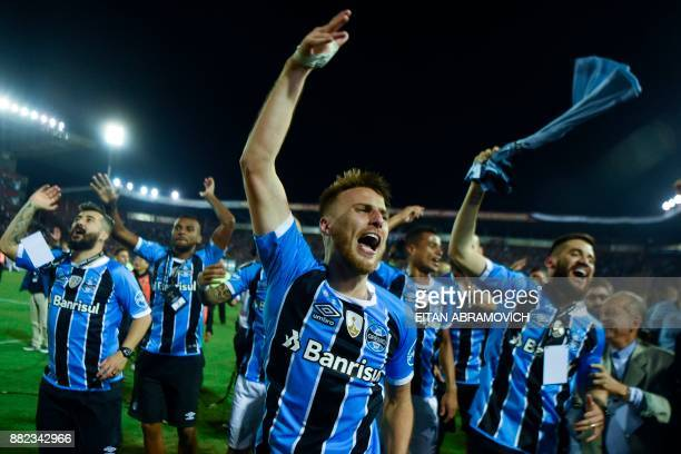 TOPSHOT Brazil's Gremio footballers celebrate after defeating Argentina's Lanus during the Copa Libertadores 2017 final football match at Lanus...