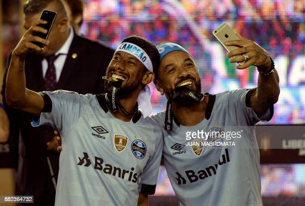 Brazil's Gremio footballers celebrate after winning the Copa Libertadores 2017 final football match against Argentina's Lanus at Lanus stadium in...