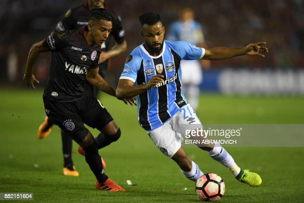 Brazil's Gremio forward Fernandinho vies for the ball with Argentina's Lanus defender Jose Gomez during their Copa Libertadores 2017 final football...