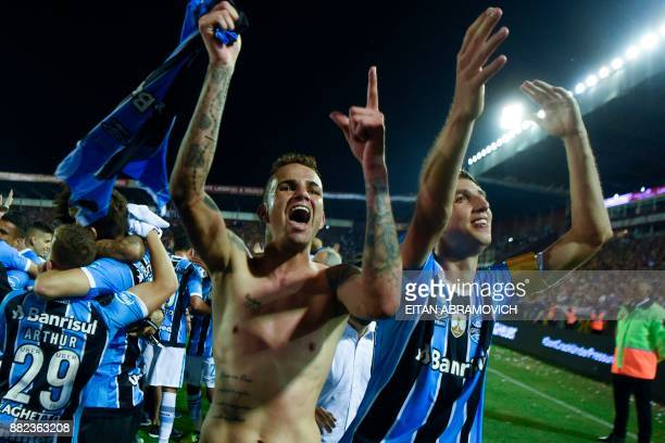 Brazil's Gremio forward Luan and defender Geromel celebrate after defeating Argentina's Lanus during the Copa Libertadores 2017 final football match...