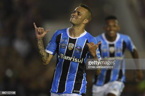 Brazil's Gremio forward Luan celebrates after scoring a goal against Argentina's Lanus during the Copa Libertadores 2017 final football match at...