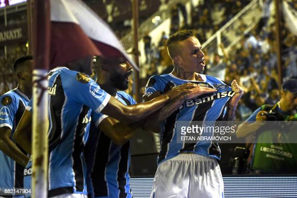 Brazil's Gremio forward Luan celebrates with teammates after scoring a goal against Argentina's Lanus during the Copa Libertadores 2017 final...