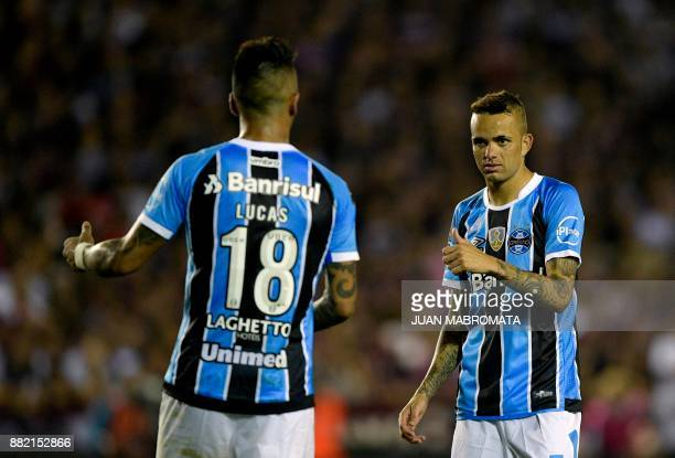 Brazil's Gremio forward Luan gestures next to forward Lucas Barrios during the Copa Libertadores 2017 final football match against Argentina's Lanus...