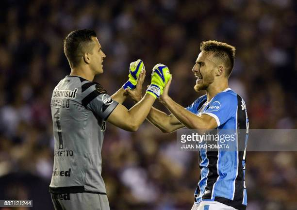 Brazil's Gremio goalkeeper Marcelo Grohe and defender Bressan celebrate after teammate forward Luan scores the team's second goal against Argentina's...