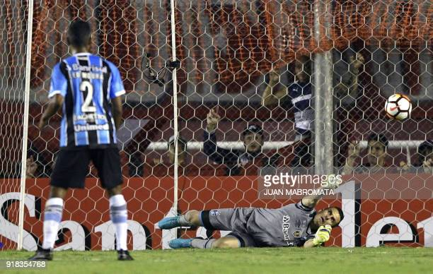 Brazil's Gremio goalkeeper Marcelo Grohe fails to stop the ball kicked by Argentina's Independiente midfielder Fernando Gaibor to scores a goal...