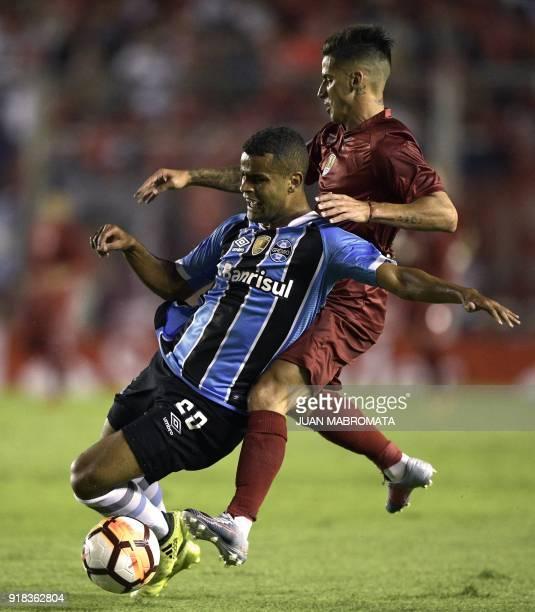 Brazil's Gremio midfielder Alisson vies for the ball with Argentina's Independiente midfielder Jonathan Menendez during their Recopa Sudamericana...