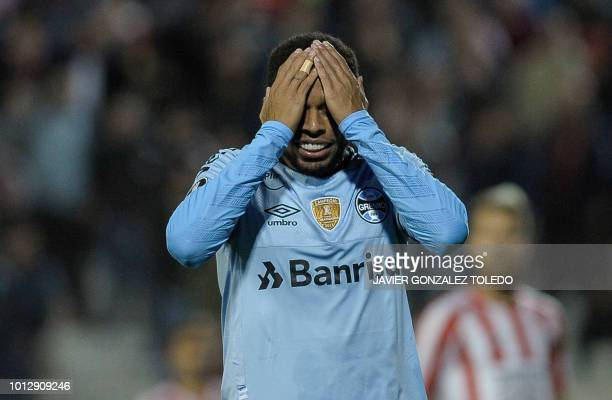 Brazil's Gremio midfielder Maicosuel reacts after missing a goal during their Copa Libertadores round of sixteen first leg football match against...