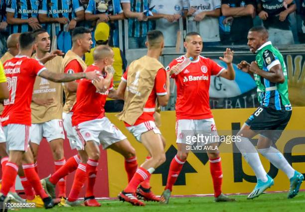 Brazil's Gremio Paulo Miranda confronts Brazil's Internacional players during their 2020 Copa Libertadores match at the Arena do Grêmio in Porto...