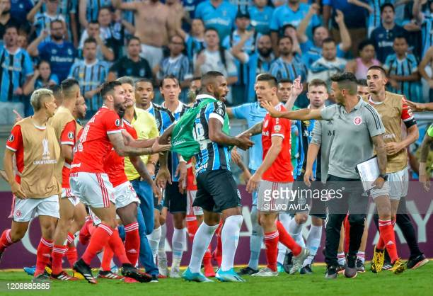Brazil's Gremio Paulo Miranda is surrounded by Brazil's Internacional players in a brawl during their 2020 Copa Libertadores match at the Arena do...