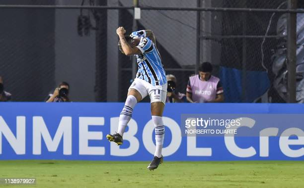 Brazil's Gremio player Everton celebrates after scoring against Paraguay's Libertad during their Copa Libertadores football match at Defensores del...