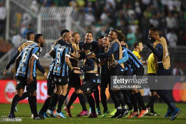 Brazil's Gremio players celebrate after defeating Brazil's Palmeiras during their 2019 Copa Libertadores football match at Pacaembu stadium in Sao...