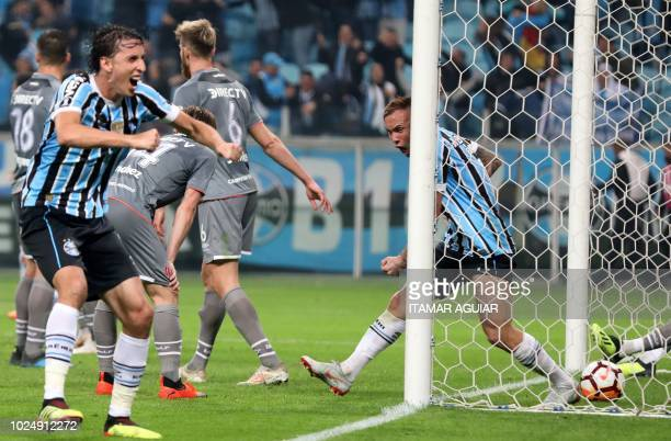 Brazil's Gremio players celebrates after scoring against Argentina's Estudiantes during their Copa Libertadores 2018 football match held at the Arena...
