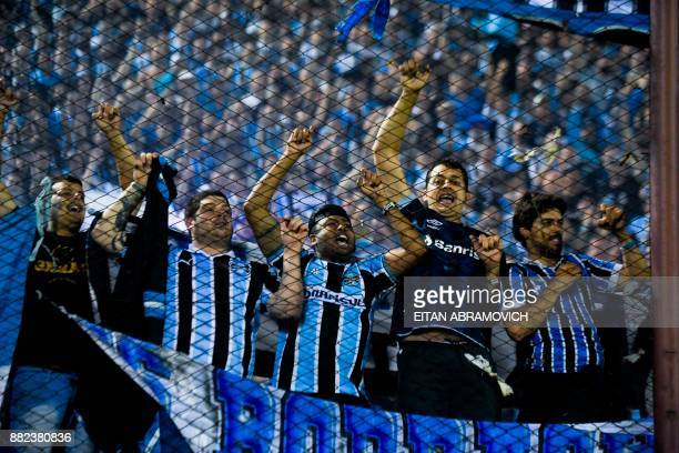 Brazil's Gremio supporters celebrate their team's victory in the Copa Libertadores 2017 final football match against Argentina's Lanus at Lanus...