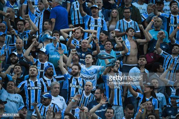 Brazil's Gremio supporters cheer for their team during the Copa Libertadores 2017 final football match against Argentina's Lanus at Lanus stadium in...