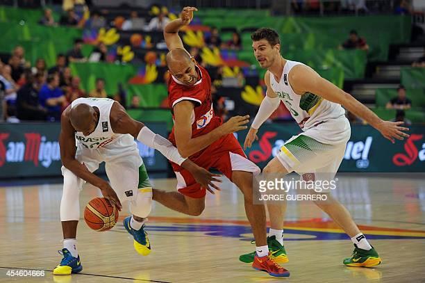 Brazil's guard Leandrinho Barbosa and centre Tiago Splitter vies with Egypt's forward Moamen Abouelanin during the 2014 FIBA World basketball...