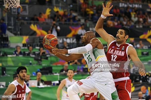 Brazil's guard Leandrinho Barbosa vies with Iran's centre Asghar Kardoust during the 2014 FIBA World basketball championships group A match Brazil vs...