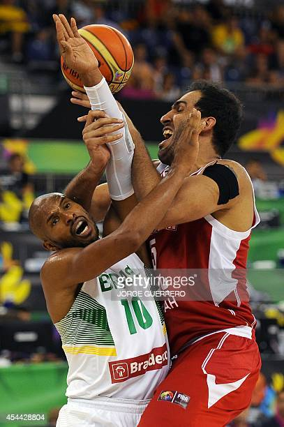 Brazil's guard Leandrinho Barbosa vies with Iran's centre Hamed Haddadi during the 2014 FIBA World basketball championships group A match Brazil vs...