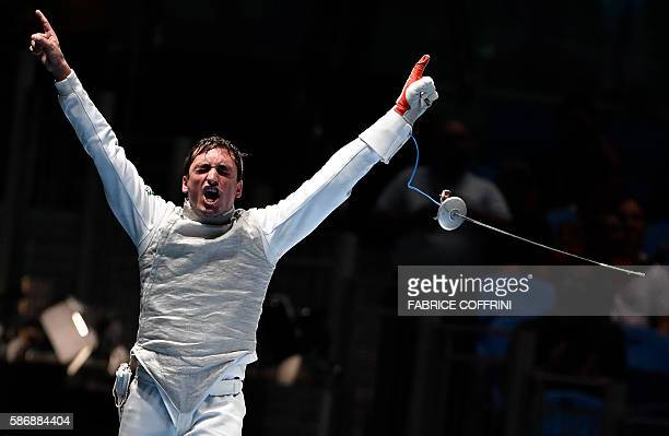 Brazil's Guilherme Toldo celebrates winning against Japan's Yuki Ota in their mens individual foil qualifying bout as part of the fencing event of...
