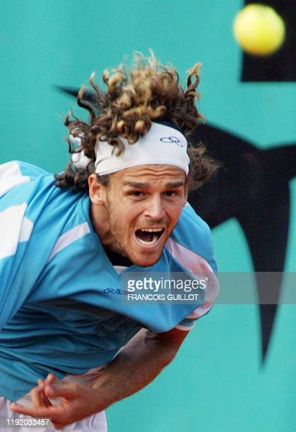 Brazil's Gustavo Kuerten eyes the ball 02 June 2003 in Paris, during his Roland Garros French Tennis Open fourth round match against Spain's Tommy...