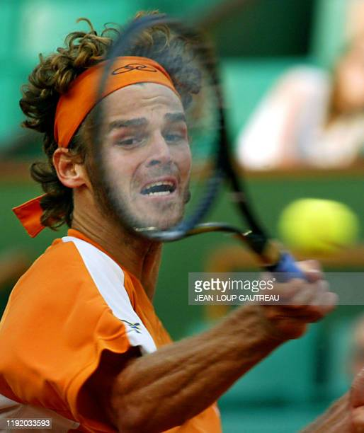 Brazil's Gustavo Kuerten hits a forehand to his Spanish opponent Albert Costa, 02 June 2002 in Paris, during a Roland-Garros French Open fourth round...