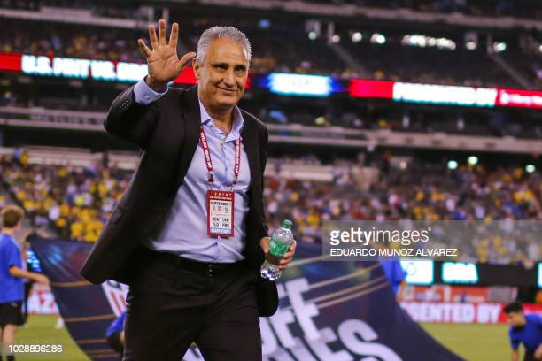 Brazil's head coach Tite waves to the crowd during the international friendly match between Brazil and the US at the Metlife Stadium in East...