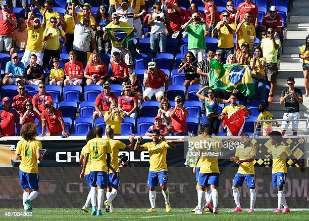 Brazil's Hulk is congratulated by teammates after scoring a goal during the friendly match between Brazil and Costa Rica on September 5 2015 at Red...