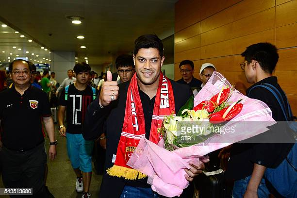 Brazil's Hulk makes his way through the arrivals halls at Shanghai Pudong International Airport on June 29 2016 Zenit St Petersburg's Brazilian...