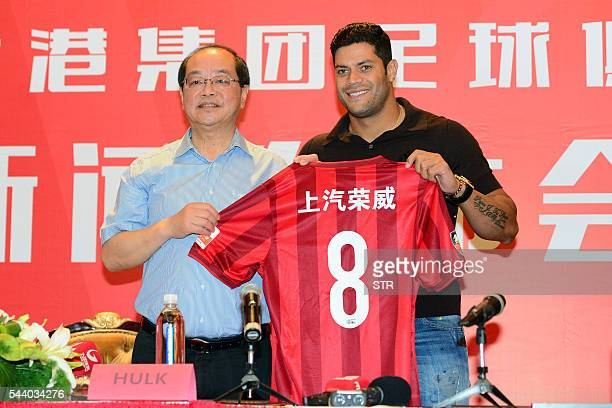 Brazil's Hulk poses with his new jersey during a press conference for joining Shanghai SIPG Football Club in Shanghai on July 1 2016 Zenit St...