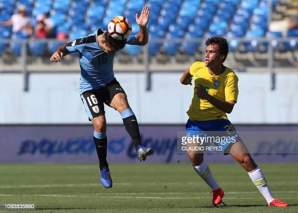 Brazil's Igor vies for the ball with Uruguay's Nicolas Acevedo during their South American U20 football match at El Teniente stadium in Rancagua...