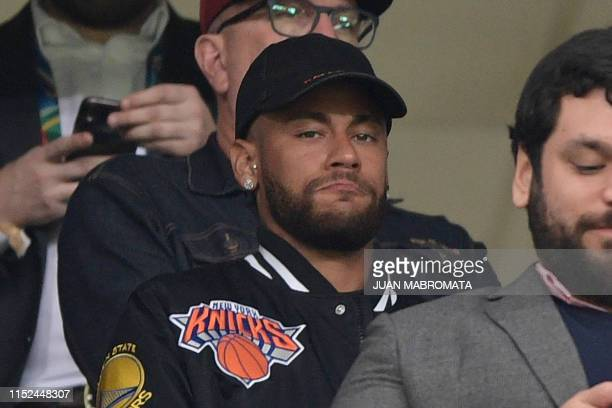 TOPSHOT Brazil's injured player Neymar is seen on the stands before the start of the Copa America football tournament quarterfinal match between...