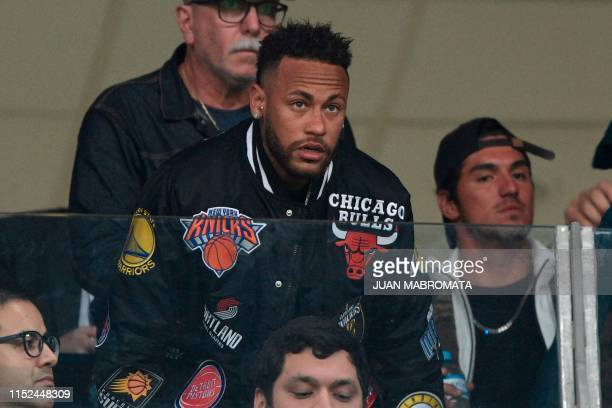 Brazil's injured player Neymar is seen on the stands before the start of the Copa America football tournament quarterfinal match between Brazil and...