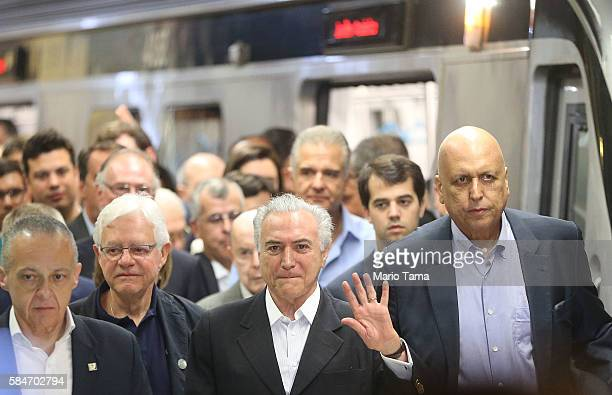 Brazil's interim President Michel Temer and Rio de Janeiro Governor Luiz Fernando de Silva depart after riding on the new Metro Line 4 subway train...
