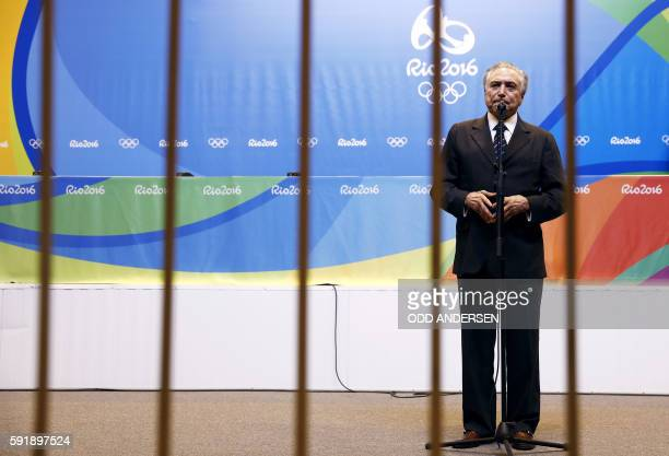 TOPSHOT Brazil's interim president Michel Temer gives a statement during a visit at the Olympic park in Rio de Janeiro on August 18 2016 during the...